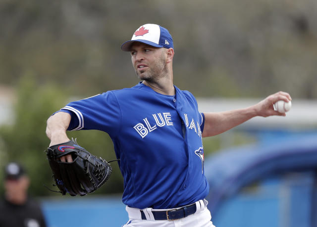 Toronto Blue Jays' J.A. Happ pitches against the Boston Red Sox in the first inning a spring baseball exhibition game, Monday, March 12, 2018, in Dunedin, Fla. (AP Photo/John Raoux)