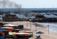 Smoke billows from a beach shack following an Israeli military strike, on July 16, 2014 in Gaza City which killed four children, medics said (AFP Photo/Thomas Coex)