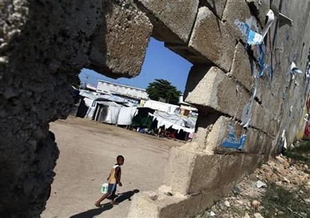 A boy walks inside a makeshift camp for earthquake survivors in Port-au-Prince