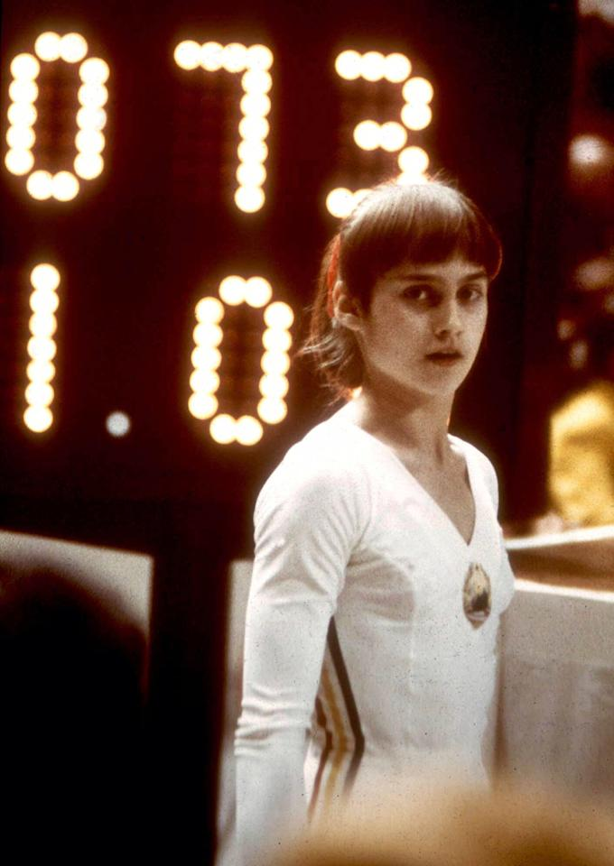 Romanian gymnast Nadia Comaneci stands before a scoreboard in Montreal, Canada, July 18, 1976. The young gymnast racked up three perfect scores of 10 during the Olympic Games in Montreal. It is the first time in the history of the Olympic games that anyone received a perfect score. (AP Photo)