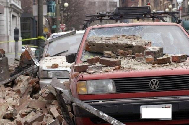 Car with debris from earthquake