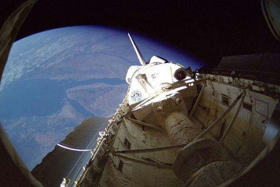 """<img alt=""""""""/><p>NASA and the U.S. military weave a tangled web.</p> <p>Ostensibly, NASA is run by civilians. Its astronauts aren't active duty service members and NASA officials aren't military either. However, if you examine the history of the space agency, it becomes clear that the reality is more complicated.</p> <div><p>SEE ALSO: <a rel=""""nofollow"""" href=""""http://mashable.com/2011/07/08/space-shuttle-launch-video-atlantis/?utm_campaign=Mash-BD-Synd-Yahoo-Science-Full&utm_cid=Mash-BD-Synd-Yahoo-Science-Full"""">Space Shuttle Atlantis Launch Video: The Final Flight</a></p></div> <p>According to <a rel=""""nofollow"""" href=""""http://paleofuture.gizmodo.com/newly-declassified-document-about-spy-satellites-on-the-1795124683"""">a report</a> by Matt Novak at <em>Gizmodo</em>, the National Reconnaissance Office (NRO) — the secretive intelligence organization responsible for the upkeep of the U.S.'s fleet of spy satellites — used NASA's space shuttles to launch multiple secret missions to orbit over the course of the decades-long program.</p> <p></p>  <p>Although that may sound shocking, these kinds of missions were actually standard.</p> <p>""""Though the NRO may have not officially acknowledged 'the fact' that it used the space shuttle to launch payloads, as suggested by the redacted document published by <em>Gizmodo</em>, the secretive agency's involvement was still largely known since the early days of the NASA 30-year program,"""" Robert Pearlman, space historian and editor of the website <a rel=""""nofollow"""" href=""""http://www.collectspace.com//"""">collectSPACE.com</a>, said in an interview.</p> <p>While it might be pretty easy to hide the specifics of what a satellite will do when it gets to orbit, it's basically impossible to hide a rocket launch, particularly the launch of a space shuttle.</p> <p><img title=""""The open payload bay of Discovery."""" alt=""""The open payload bay of Discovery.""""></p> <p>The open payload bay of Discovery.</p><div><p>Image:  nasa</p></div><p>Journalists covering the spa"""