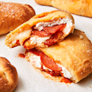 """<p>Calzones are seriously underrated. Seen as inferior to the grand pizza pie, calzones are often forgotten about, but why? They are basically an individual <a href=""""https://www.delish.com/uk/food-news/a29412360/leftover-pizza/"""" rel=""""nofollow noopener"""" target=""""_blank"""" data-ylk=""""slk:pizza"""" class=""""link rapid-noclick-resp"""">pizza</a> all wrapped up. No cheese sliding off or floppy crusts. Just pure deliciousness wrapped up in a pillowy dough. Calzones deserve their chance to shine. </p><p>Get the <a href=""""https://www.delish.com/uk/cooking/recipes/a30192888/easy-calzone-recipe/"""" rel=""""nofollow noopener"""" target=""""_blank"""" data-ylk=""""slk:Calzones"""" class=""""link rapid-noclick-resp"""">Calzones</a> recipe.</p>"""