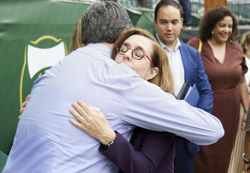 Oregon Governor Kate Brown, right, hugs an employee of the Oregon Health Authority after announcing the end of the state's COVID-19 restrictions in Portland, Ore., Wednesday, June 30, 2021. (AP Photo/Craig Mitchelldyer)