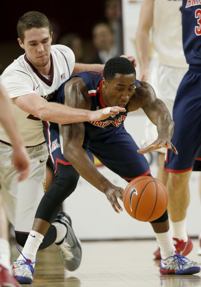 Arizona's Rondae Hollis-Jefferson, right, tries to keep the ball away from Arizona State's Eric Jacobsen during the first half of an NCAA college basketball game on Friday, Feb. 14, 2014, in Tempe, Ariz. (AP Photo/Ross D. Franklin)