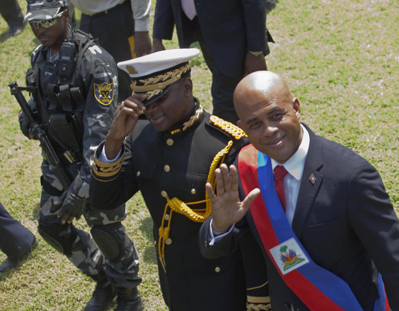 "Haiti's newly-sworn-in President Michel Martelly, right, walks with Haiti's Chief of Police Mario Andresol during Haiti's presidential inaugural ceremony at the National Palace in Port-au-Prince, Haiti, Saturday May 14,  2011. The 50-year-old performer known to Haitians as ""Sweet Micky"" was swept to power in a March 20 presidential runoff by Haitians tired of past leaders who failed to provide even basic services, such as decent roads, water and electricity in the Western Hemisphere's poorest country. (AP Photo/Ramon Espinosa)"
