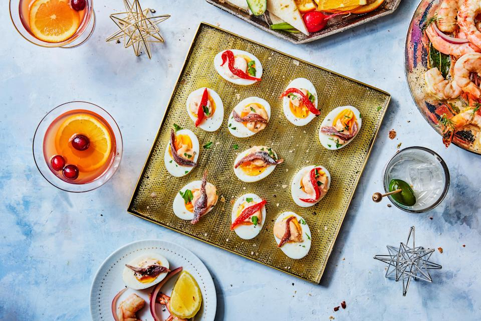 """This simple summer snack is just as delicious as deviled eggs, but a whole lot easier to make. The condiment on top is a simple jazzed-up mayo—no piping required. <a href=""""https://www.epicurious.com/recipes/food/views/jammy-eggs-with-smoked-paprika-aioli?mbid=synd_yahoo_rss"""" rel=""""nofollow noopener"""" target=""""_blank"""" data-ylk=""""slk:See recipe."""" class=""""link rapid-noclick-resp"""">See recipe.</a>"""
