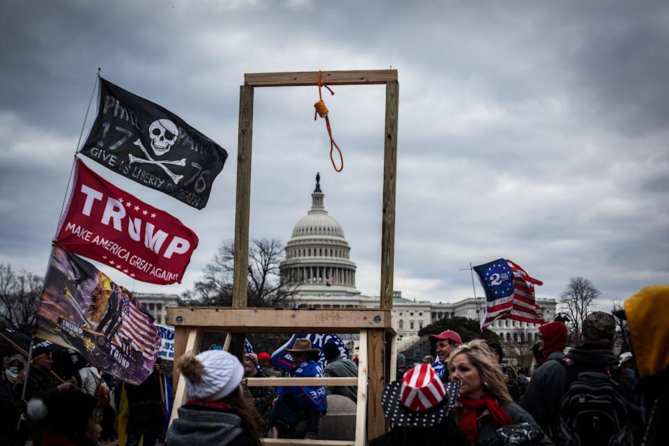 Trump supporters demonstrate with flags and a makeshift noose outside the U.S. Capitol, Jan. 6, 2021. (Photo by Shay Horse/NurPhoto via Getty Images)