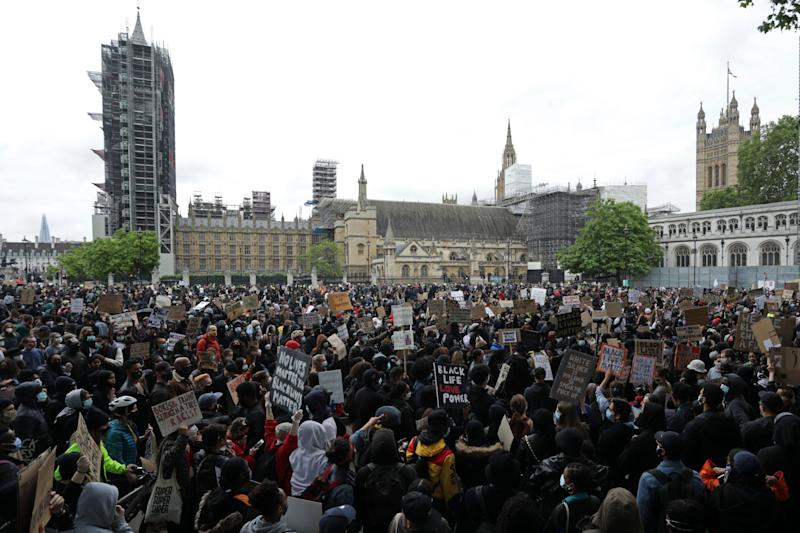 Protesters gather in Parliament Square in front of the Palace of Westminster in central London after attending a demonstration outside the US Embassy, on June 7, 2020, organised to show solidarity with the Black Lives Matter movement in the wake of the killing of George Floyd, an unarmed black man who died after a police officer knelt on his neck in Minneapolis. - Taking a knee, banging drums and ignoring social distancing measures, outraged protesters from Sydney to London on Saturday kicked off a weekend of global rallies against racism and police brutality. (Photo by ISABEL INFANTES / AFP) (Photo by ISABEL INFANTES/AFP via Getty Images)