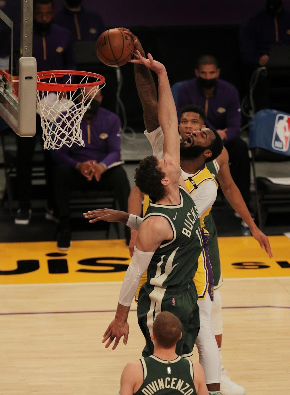 Lakers Andre Drummond tries to dunk over Milwaukee Bucks center Brook Lopez.