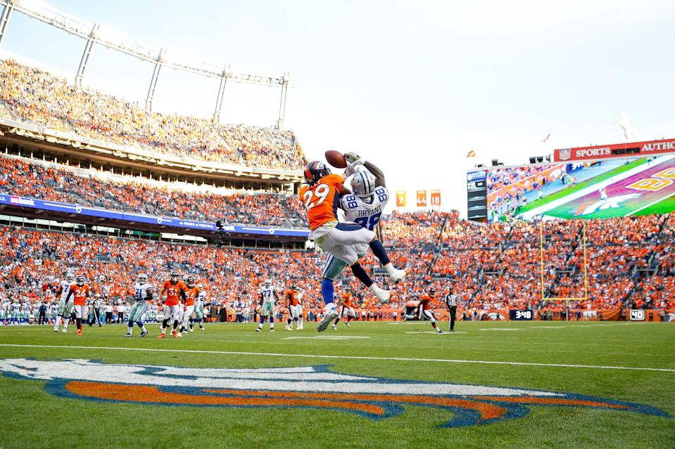 Dez Bryant tangles with cornerback Bradley Roby in a September game last season. (Getty Images)