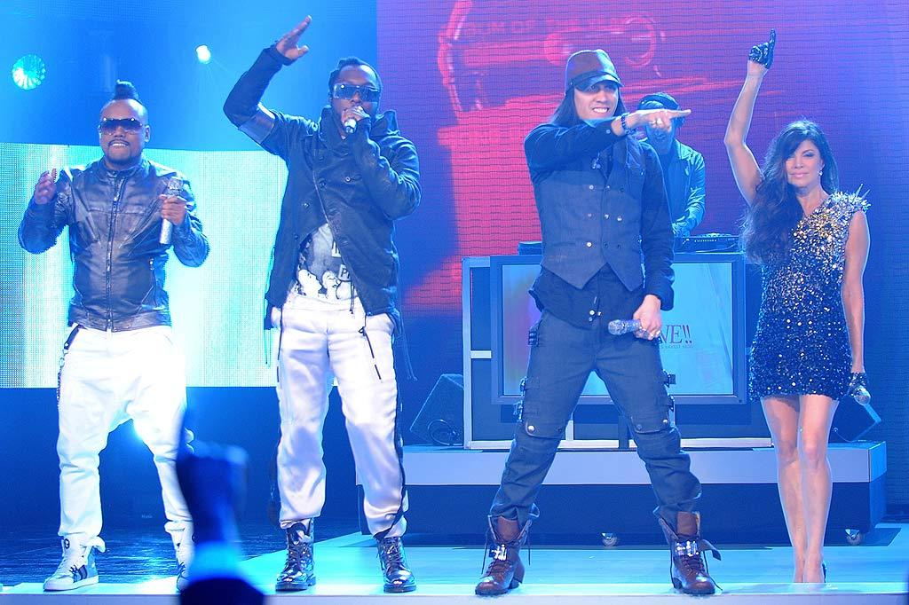 """The Black Eyes Peas' apl.de.ap, will.i.am, Taboo, and Fergie -- who received a staggering 6 noms -- rocked the crowd with a medley of their biggest hits. Michael Caulfield/<a href=""""http://www.wireimage.com"""" target=""""new"""">WireImage.com</a> - December 2, 2009"""