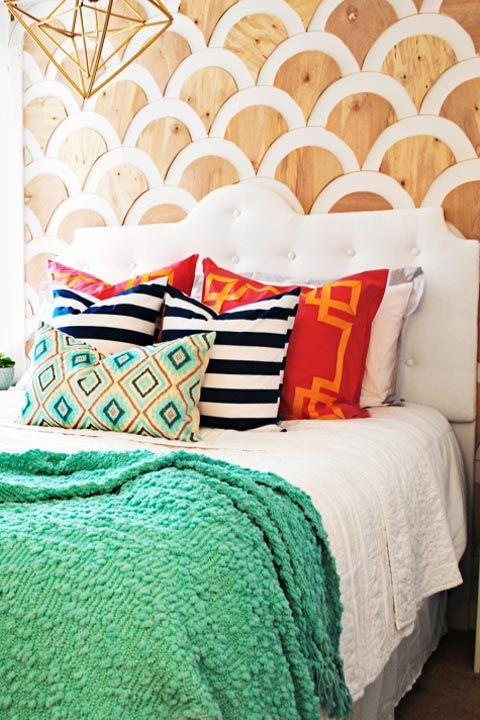 """<p><span class=""""redactor-invisible-space"""">Proof that you can make a statement wall in your bedroom without a ton of effort: <a href=""""https://www.goodhousekeeping.com/home/craft-ideas/g2493/diy-scallop-wall/"""" rel=""""nofollow noopener"""" target=""""_blank"""" data-ylk=""""slk:This blogger"""" class=""""link rapid-noclick-resp"""">This blogger</a> used plywood and mounting tape to create this envy-inducing decor moment.</span><span class=""""redactor-invisible-space""""><br></span><span class=""""redactor-invisible-space""""><br></span><span class=""""redactor-invisible-space""""><span class=""""redactor-invisible-space""""><a href=""""https://www.goodhousekeeping.com/home/craft-ideas/g2493/diy-scallop-wall/"""" rel=""""nofollow noopener"""" target=""""_blank"""" data-ylk=""""slk:Get the tutorial »"""" class=""""link rapid-noclick-resp""""><em>Get the tutorial »</em></a></span></span> </p>"""