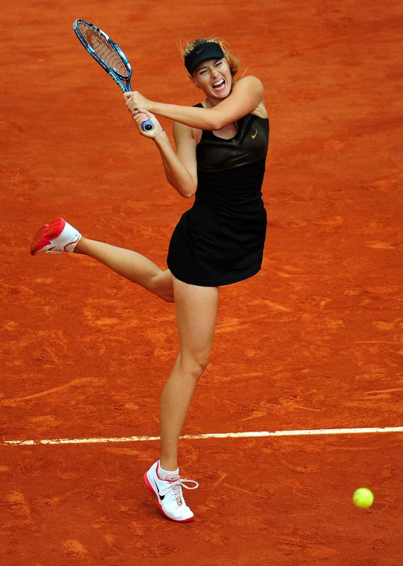 PARIS, FRANCE - JUNE 09:  Maria Sharapova of Russia plays a backhand in the women's singles final against Sara Errani of Italy during day 14 of the French Open at Roland Garros on June 9, 2012 in Paris, France.  (Photo by Mike Hewitt/Getty Images)