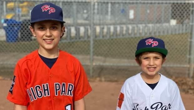 Peter Paz's sons, William, 11, and Hudson, 8, pictured here in their High Park Little League baseball uniforms.
