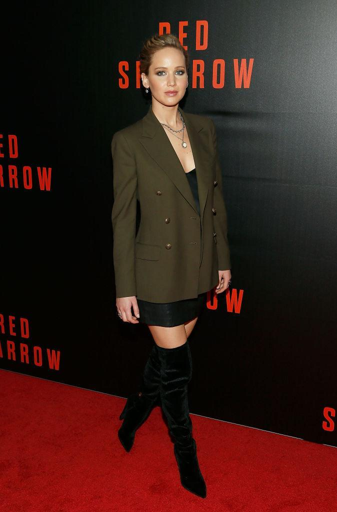 <p>For the Washington DC screening of her latest hit film, 'Red Sparrow,' Jennifer Lawrence donned a khaki-green blazer and thigh-high boots. <em>[Photo: Getty]</em> </p>