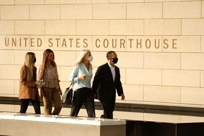 LOS ANGELES, CA. JULY 7, 2020 -- Former Los Angeles city councilman Mitch Englander, right, arrives at the Federal Courthouse in downtown Los Angeles with life wife, Jayne, daughters, Lauren, left and Lindsey, Tuesday morning July 7, 2020.