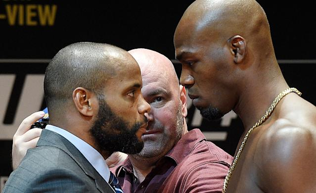 Daniel Cormier (L) hasn't been able to beat his nemesis, Jon Jones, in their two fights against one another. (Getty)