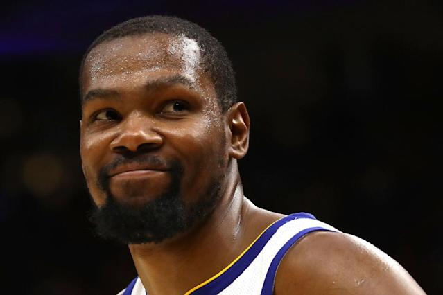 Kevin Durant smiles like a man who knows there's not a single dude in the other jerseys who can guard him. (Getty)