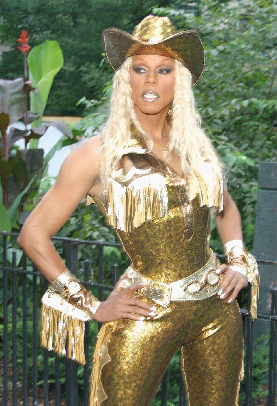 <p>More gold in this glam cowboy look for Wigstock. That tiny waist is to die for.</p>
