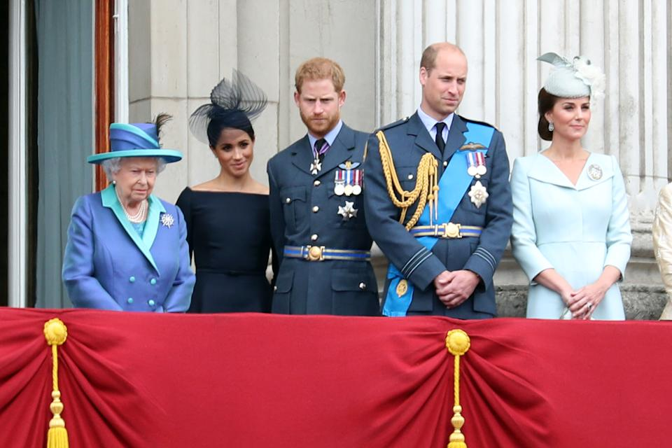 Queen Elizabeth II, Meghan, Duchess of Sussex, Prince Harry, Duke of Sussex, Prince William, Duke of Cambridge and Catherine, Duchess of Cambridge watch the RAF flypast on the balcony of Buckingham Palace, as members of the Royal Family attend events to mark the centenary of the RAF on July 10, 2018 in London, England.