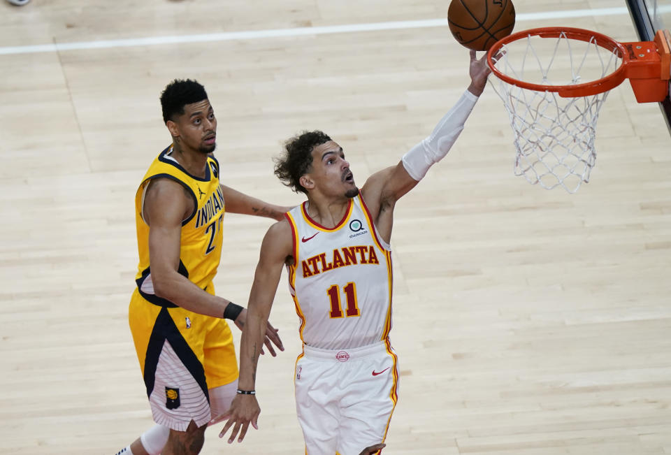 Atlanta Hawks Trae Young (11) shoots and scores during the second half of an NBA basketball game against the Indiana Pacers on Sunday, April 18, 2021, in Atlanta. (AP Photo/Brynn Anderson)