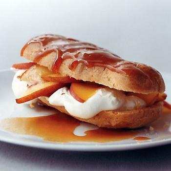 """Bourbon lends depth to the sauce and extra sweetness to the cream filling, but this dessert is fantastic even without it. <a href=""""https://www.epicurious.com/recipes/food/views/peaches-n-cream-eclairs-with-bourbon-caramel-sauce-238976?mbid=synd_yahoo_rss"""">See recipe.</a>"""