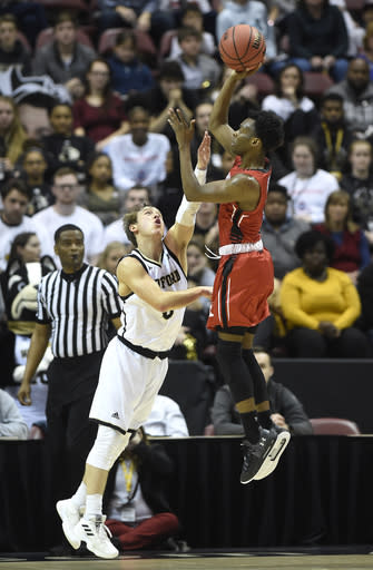 VMI guard Bubba Parham (3) takes aim for the basket over Wofford guard Storm Murphy (5) in the first half of an NCAA college basketball game for the Southern Conference basketball tournament championship, Saturday, March 9, 2018, in Asheville, N.C. Wofford won 99-72. (AP Photo/Kathy Kmonicek)