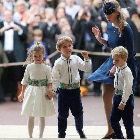The bridesmaids and pageboys including Prince George arrive with Lady Louise Mountbatten-Windsor  - Credit: AFP