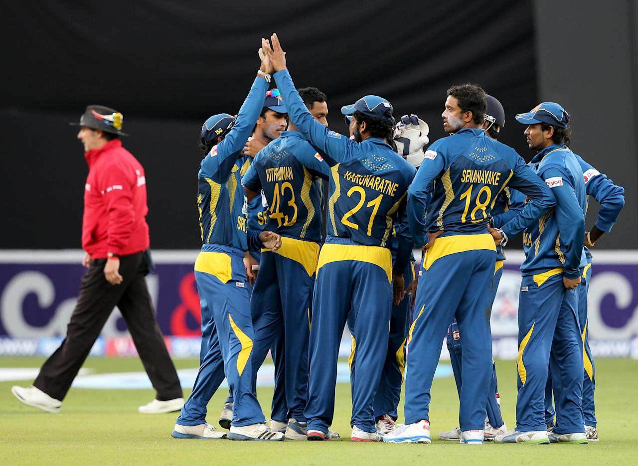DUBAI, UNITED ARAB EMIRATES - DECEMBER 20:  Players of Sri Lanka celebrate after dismissing Mohammad Hafeez of Pakistan during the second One-Day International (ODI ) match between Sri Lanka and Pakistan at the Dubai Sports City Cricket Stadium on December 20, 2013 in Dubai, United Arab Emirates.  (Photo by Francois Nel/Getty Images)