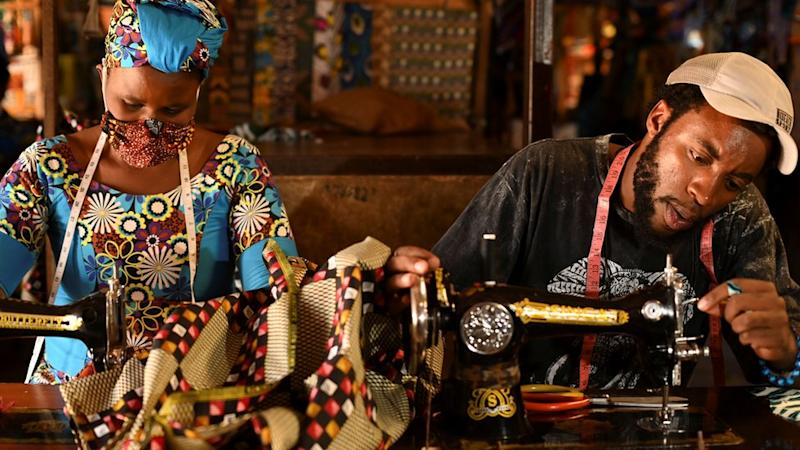 Tailors in Rwanda making traditional African fabric masks