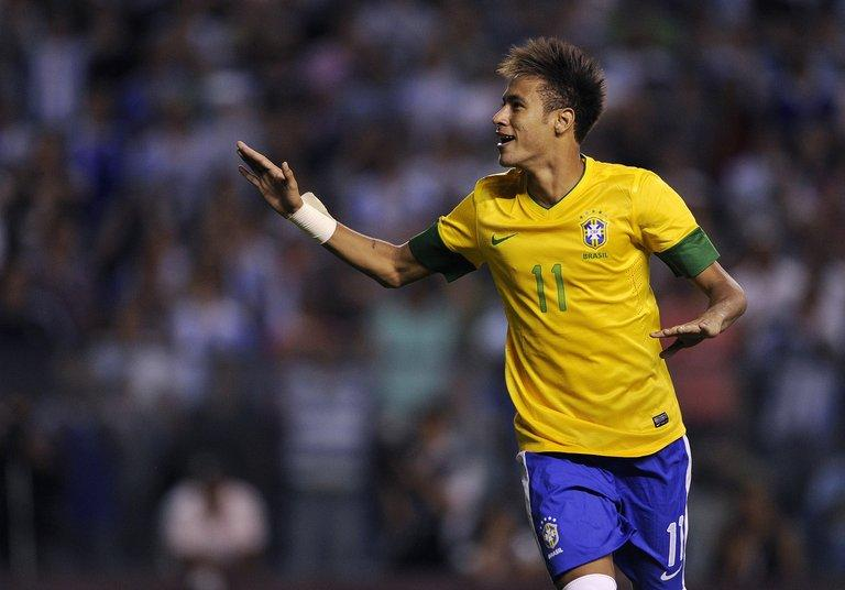 Neymar celebrates after scoring a penalty kick at La Bombonera stadium in Buenos Aires on November 21, 2012