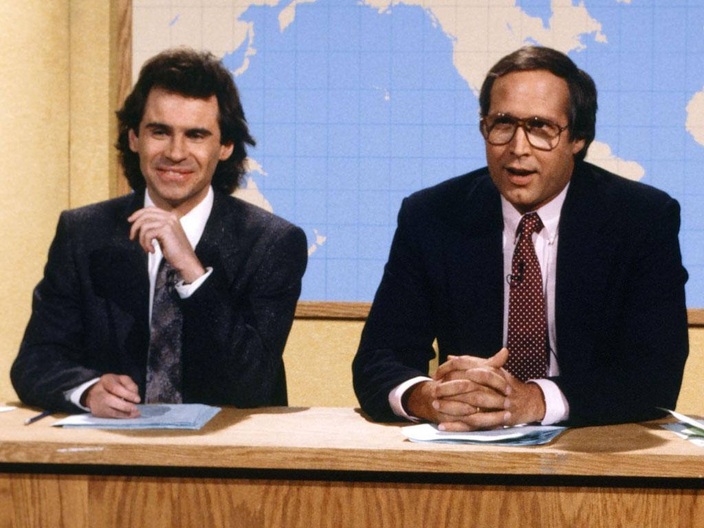SATURDAY NIGHT LIVE -- Episode 6 -- Pictured: (l-r) Dennis Miller. Chevy Chase during the 'Weekend Update' on December 6, 1986 -- Photo by: Al Levine/NBC/NBCU Photo Bank