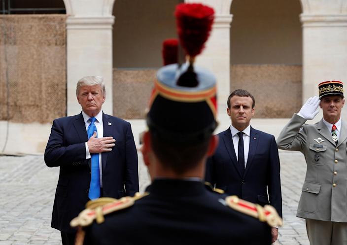 <p>French President Emmanuel Macron and President Donald Trump listen to national anthems as they review troops during a welcoming ceremony at the Invalides in Paris, France, July 13, 2017. (Photo: Yves Herman/Reuters) </p>