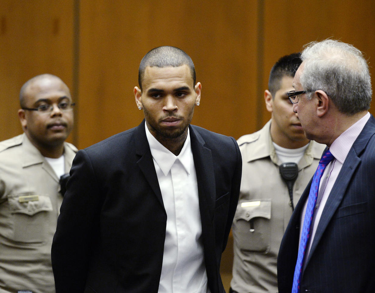 LOS ANGELES, CA - AUGUST 16:  R&B singer Chris Brown appears in court with his attorney Mark Geragos for a probation hearing on August, 16 2013 in Los Angeles, California.  Brown's probation has been reinstated and he must perform 1,000 hours of community service.  Brown was first placed on probation after the 2009 domestic violence case in which he pleaded guilty to assaulting his then-girlfriend singer Rihanna.  (Photo by Kevork Djansezian/Getty Images)