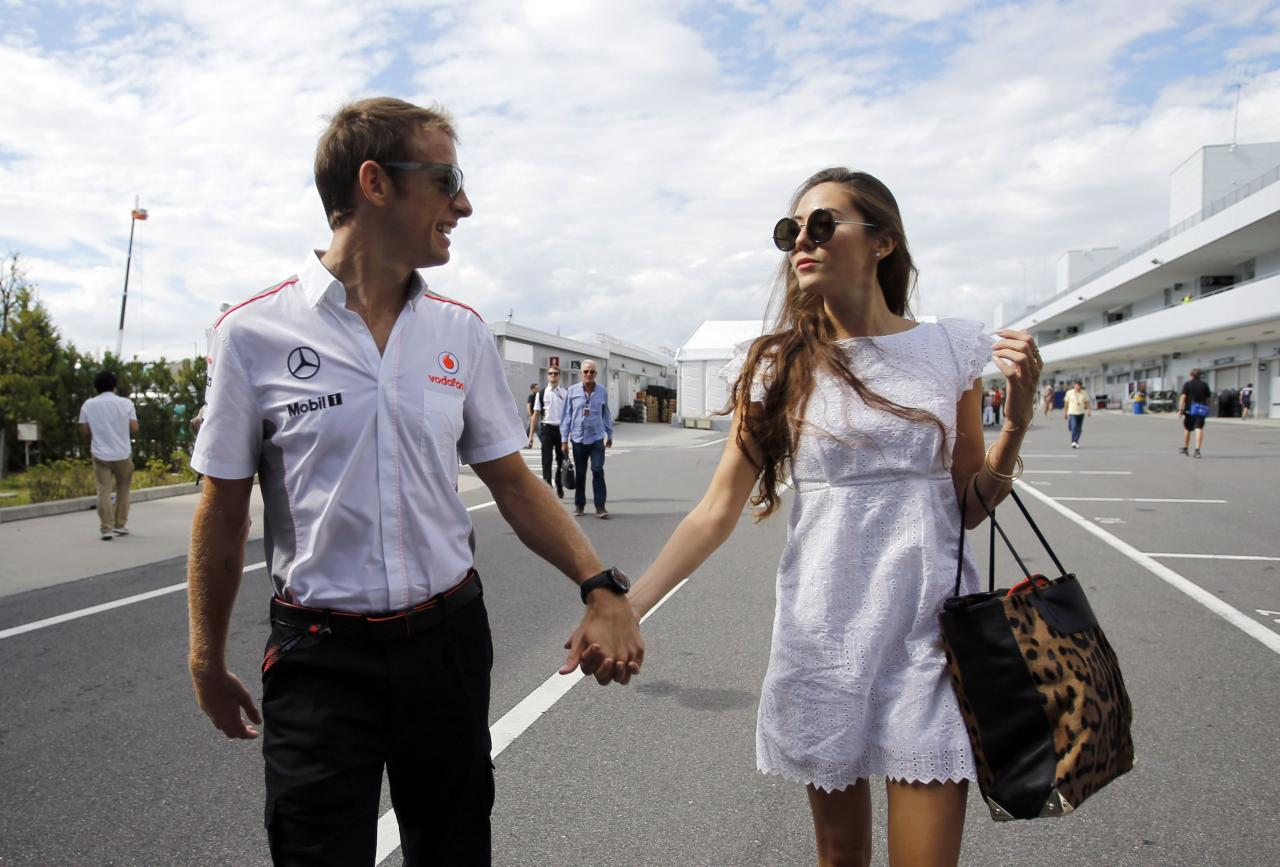 McLaren Formula One driver Jenson Button of Britain and his girlfriend, Japanese-Argentine model Jessica Michibata, arrive at the Suzuka circuit in Suzuka October 10, 2013, ahead of Sunday's Japanese F1 Grand Prix. REUTERS/Issei Kato (JAPAN - Tags: SPORT MOTORSPORT F1 ENTERTAINMENT FASHION)