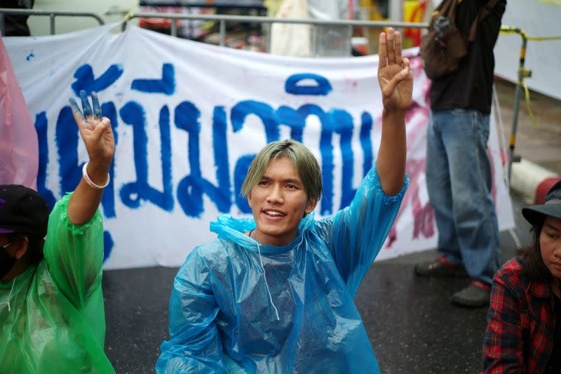 """Pro-democracy protester Songphon """"Yajai"""" Sonthirak does a three-finger salute during a mass rally in Bangkok"""