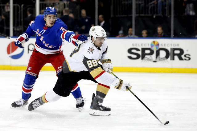 New York Rangers defenseman Brady Skjei (76) cannot stop Vegas Golden Knights right wing Alex Tuch (89) from shooting on goal during the first period of an NHL hockey game, Monday, Dec. 2, 2019, in New York. (AP Photo/Kathy Willens)