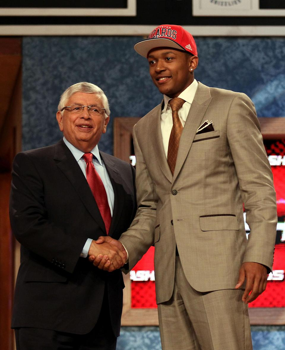 NEWARK, NJ - JUNE 28: Bradley Beal (R) of the Florida Gators greets NBA Commissioner David Stern (L) after he was selected number three overall by the Washington Wizards during the first round of the 2012 NBA Draft at Prudential Center on June 28, 2012 in Newark, New Jersey. NOTE TO USER: User expressly acknowledges and agrees that, by downloading and/or using this Photograph, user is consenting to the terms and conditions of the Getty Images License Agreement. (Photo by Elsa/Getty Images)