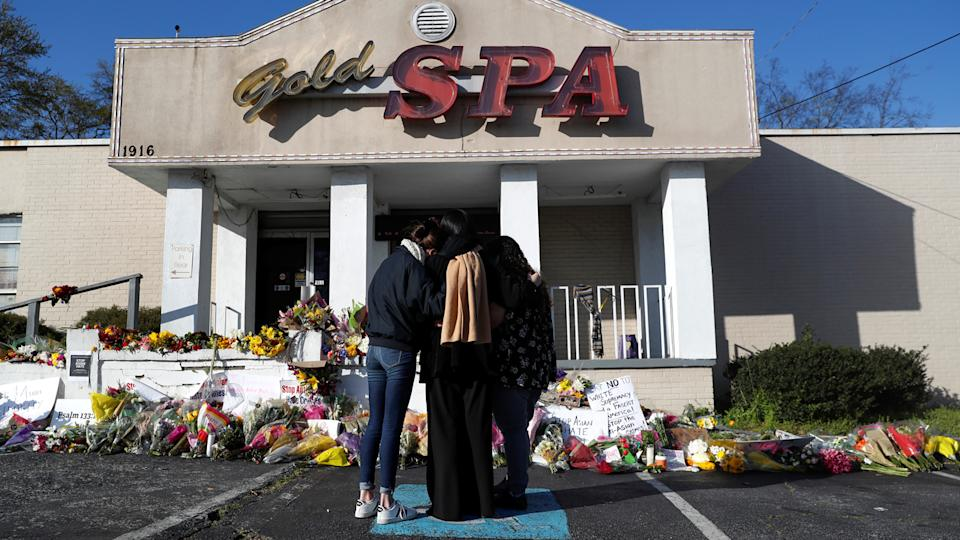 People embrace by a makeshift memorial outside the Gold Spa following the deadly shootings in Atlanta, Georgia, U.S. March 20, 2021. (Shannon Stapleton/Reuters)