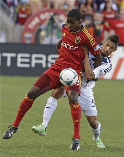 Real Salt Lake forward Olmes Garcia, left, and Los Angeles Galaxy defender Sean Franklin (5) battle for a ball during the first half of an MLS soccer game Saturday, April 27, 2013, Sandy, Utah. (AP Photo/Rick Bowmer)