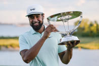 Tony Finau poses with the Wanamaker Trophy after winning The Northern Trust golf tournament at Liberty National Golf Course Monday, Aug. 23, 2021, in Jersey City, N.J. (AP Photo/John Minchillo)