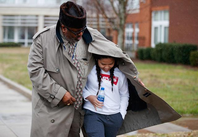 <p>A father shelters his daughter, a student from Great Mills High School, from the rain as they picks her up from Leonardtown High School in Leonardtown, Md., Tuesday, March 20, 2018. (Photo: Carolyn Kaster/AP) </p>