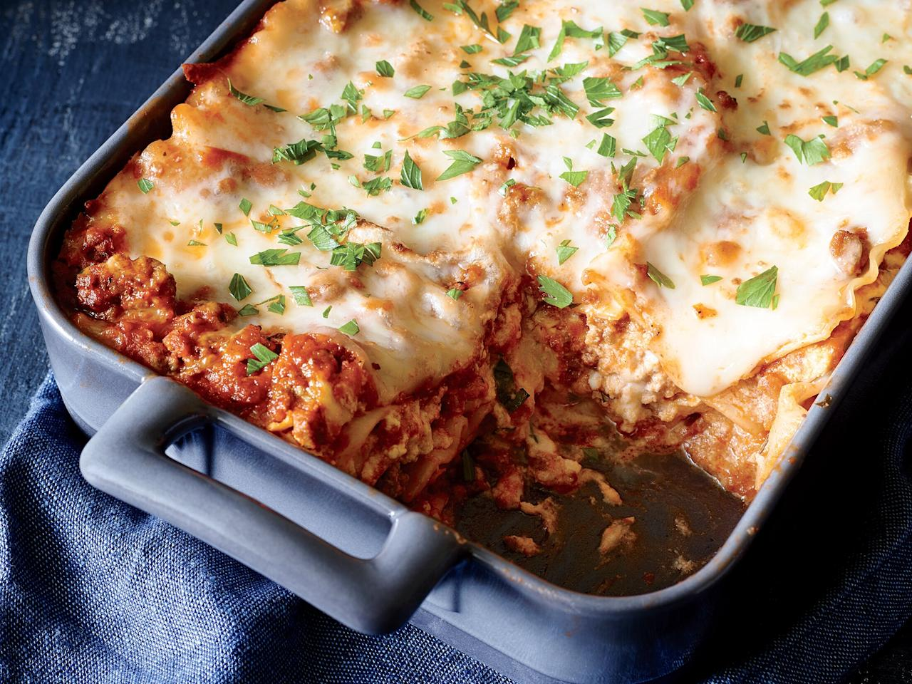 """<p>This simple lasagna is perfect for when you're short on time, but craving a comforting meal. Ready in just over an hour, it requires only 50 minutes of cooking in the oven.</p> <p>Extra-lean ground beef (which sometimes cooks up dry) works well here because it's combined with marinara to keep it moist. For a quick and easy variation, feel free to use 9 whole lasagna noodles instead of 6 broken noodles, using 3 noodles per layer. You also can sub fresh basil leaves for the parsley sprinkled on at the end. </p> <p><a href=""""https://www.myrecipes.com/recipe/classic-lasagna-meat-sauce"""">Classic Lasagna with Meat Sauce Recipe</a></p>"""