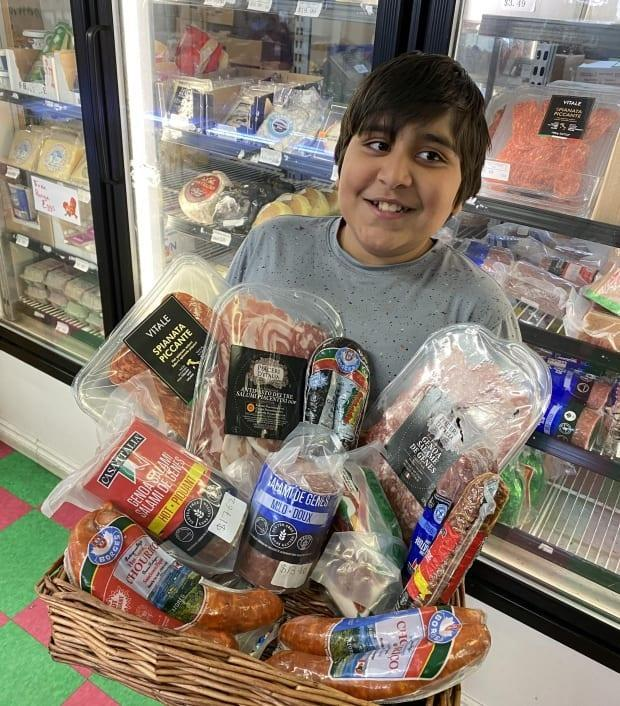 Aarav with some of the products he advertises in his videos. (Submitted by Riz Gaba - image credit)