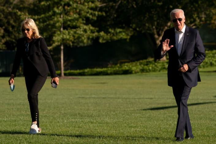 Jill Biden and President Joe Biden arrive at the White House in Washington, Sunday, Sept. 26, 2021, after returning from a weekend at Camp David. - Credit: AP