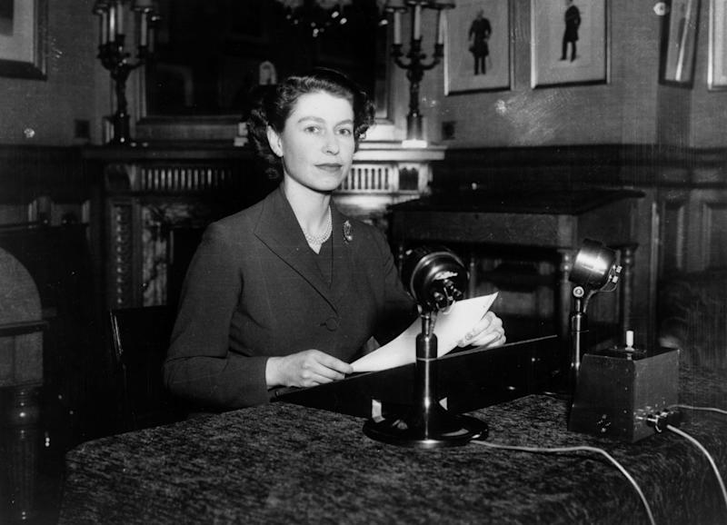 Queen Elizabeth II making her first-ever Christmas broadcast to the nation from Sandringham House in Norfolk on December 25, 1952.