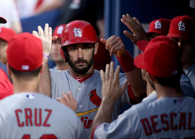St. Louis Cardinals' Matt Carpenter, center, celebrates a run off a two RBI single by Cardinals' Matt Holliday in the fourth inning of a baseball game against the Atlanta Braves, Wednesday May 7, 2014, in Atlanta. (AP Photo/Jason Getz)