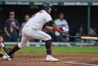 Cleveland Indians' Eddie Rosario watches his RBI double in the third inning of the team's baseball game against the Baltimore Orioles, Wednesday, June 16, 2021, in Cleveland. (AP Photo/Tony Dejak)