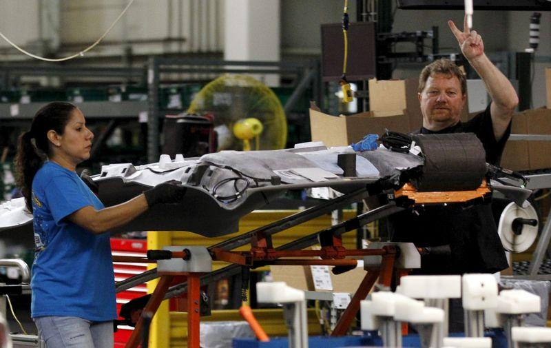 UAW worker gestures at the General Motors Assembly Plant in Arlington, Texas